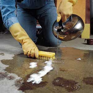 How to remove grease spots from cement the red team blog for Removing oil stains from concrete garage floor