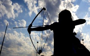Gabrielle Parker, 9, of Enid takes aim during a Junior Olympic Archery Development Club shoot put on by the Trosper Archery Club on Saturday, August 24, 2013, at Trosper Park in Oklahoma City. Parker has come down from Enid about 4 times this summer and was one of over 60 participants, from beginners to intermediates, that took part in the shoot which takes place every Saturday. For $5 each person is supplied with equipment and instruction starting at 9am for beginners and 10am for intermediate shooters. Photo by Bryan Terry, The Oklahoman